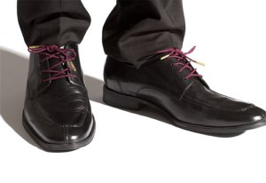 Black dress shoes with proper round laces